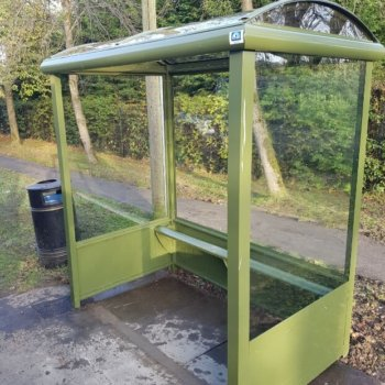 Heritage Bus Shelter with optional solid lower panels and perch seating