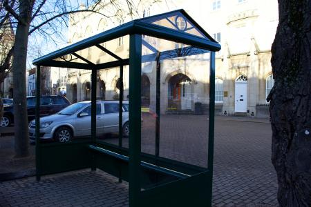 3 Bay Harrogate Bus Shelter with full end panels, solid lower panels and perch seating